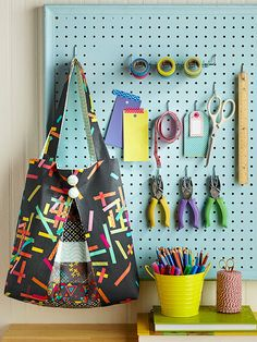 Transform standard white pegboard into a stylish focal point by adding a coat of paint and some trim. Shop around a home improvement store for hardware and S hooks to hang crafting items or office supplies from./