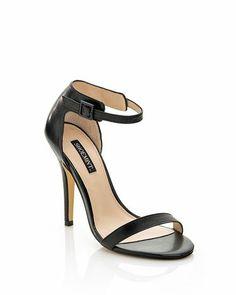 Black heels with open toe.