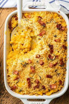 Baked Pumpkin Bacon Mac and Cheese is the ULTIMATE comfort food for Fall! Autumn in a casserole dish! Loaded with cheese, bacon, pumpkin, sage, and more cheese. BEST MACARONI AND CHEESE EVER!