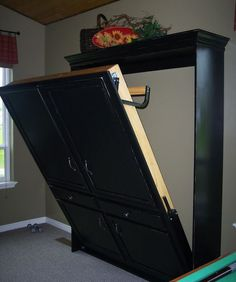 DIY murphy bed - made to look like armoire - guest bedroom. You'll need to read the comments for where to purchase the Murphy Bed mechanism kit, if you're interested in this project. This would be so useful in an office-guest room. Cama Murphy, Murphy Bed Ikea, Murphy Bed Plans, Do It Yourself Furniture, Diy Furniture, Furniture Plans, System Furniture, Furniture Chairs, Furniture Projects