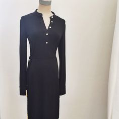 Calvin Klein black dress Calvin Klein black dress. Rayon with gold buttons and tassels on the tie belt. I am a size 4 and it fits great Calvin Klein Dresses