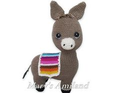 I wanted to create a four-footed animal with minimal sewing required. I thought a donkey would be perfect for my challenge. I took me a few attempts before coming up with a sketch I wished to crochet. That was Laurence with a colorful blanket on his back. Basic Crochet Stitches, Crochet Basics, The Donkey, Crochet Patterns Amigurumi, Cute Pattern, Pattern Making, Handmade Gifts, Etsy Seller, How To Make