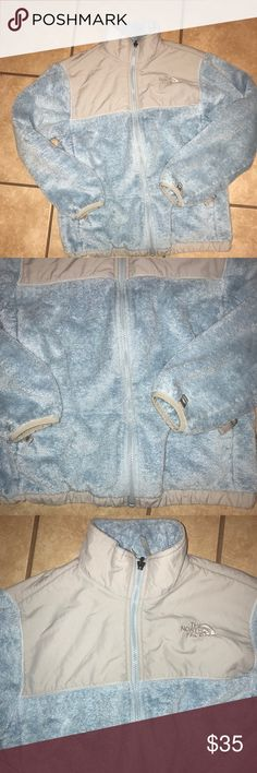 Blue and gray north face jacket This is a girls large witch I think would fit up to a small or even medium in women's. It's in great condition but does have a name written inside on the belong to space. In addition there is a stain on the back of the sleeve (see pic) which may come out (I have not tried) The North Face Jackets & Coats