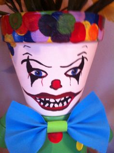 Our Clowns are very popular during Halloween Have Garden Friends make a for your Here is a off coupon for your order with us Use at checkout Halloween Clown Scary, Halloween Clay, Halloween Flowers, Halloween Crafts, Halloween Decorations, Costume Halloween, Flower Pot Art, Clay Flower Pots, Flower Pot Crafts