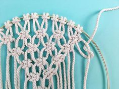 Learn how to make a DIY macrame wall hanging in a brass ring, in this free macrame tutorial pattern from Brooklyn Craft Company. Macrame Wall Hanging Patterns, Yarn Wall Hanging, Wall Hangings, Homemade Dream Catchers, How To Do Macrame, Dream Catcher Patterns, Dream Catcher Tutorial, Free Macrame Patterns, Half Hitch Knot