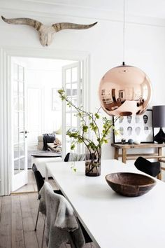 Bright copper pendant light to warm up a modern rustic Scandinavian kitchen.