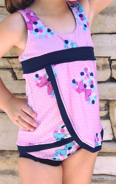 PDF Swimsuit pattern by A Sparkly Baby Patterns. The pattern has options for a two piece bikini, tankini, shorts, briefs, petal skirt, circle skirt and ruffles!! Full coverage! So many ways to make an awesome swim suit for your little girl! No binding, no elastic, and the top can be fully reversible! Sizes include 3m to girls 14!  But wait... this pattern also works perfectly for dance, gymnastics and cheer outfits!   www.etsy.com/shop/asparklybaby
