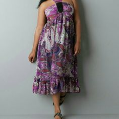"""Lane Bryant strapless dress NWT Vibrant and beautiful strapless dress from Lane Bryant in size 14/16. 100% polyester and machine washable. Elastic back for comfort. Fun paisley pattern in shades of pink and purple, lined in all black.  Measures approximately 42"""" in total length and 19"""" armpit to armpit, laid out flat, not stretched.  Never worn, tags attached.   {20% off bundles of 2 + listings} Lane Bryant Dresses Strapless"""