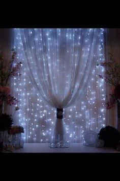 Mini Lights behind sheer fabric. Very romantic look. LED may work best for a blueish look, or old fashioned white Christmas lights for a more subtle look (Cool Designs String Lights)