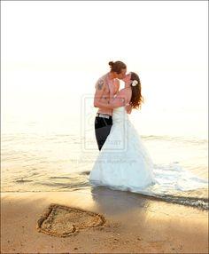 Cute beach wedding photo, maybe not shirtless though!