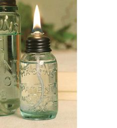 Miniature Mason Jar Oil Lamp This tiny oil lamp measures dia. Includes the jar, lid and the wick and glass wick assembly. Lamp oil is not included. Mason Jar Projects, Mason Jar Crafts, Mini Mason Jars, Mason Jar Lamp, Perfume Parfum, Chalk Paint Mason Jars, Diy Hanging Shelves, Glass Art, Aromatherapy