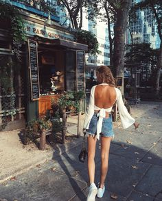 white open back wrap top, denim high waisted shorts
