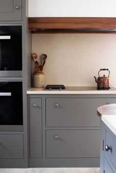A beautiful open plan barn conversion - A combination of flat panel and shaker Oak cabinetry painted with Farrow and Ball paint. Amonia stained reclaimed oak cooker hood. Sustainable Kitchens