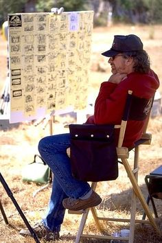 """Steven Spielberg reviewing the storyboards between scenes of """"The Lost World: Jurassic Park"""" (1997)"""
