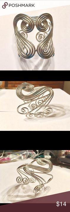 Swirly shaped silver bangle Swirly shaped silver bangle bought at a Jersey Shore boutique. Never worn! Jewelry Bracelets