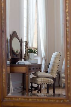 French classic bed room reflecting through antique mirror www.chateaurobertfrance.fr