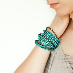 Turquoise and brown wood bead on brown cotton string by Tumach, €18.00