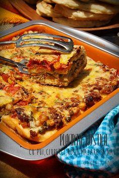 Placinta rustica umpluta cu pui, ciuperci, rosii, mazare si naut