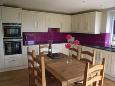 kitchen diner in extension with purple splashback, quartz resin worktop, and engineered oak floor