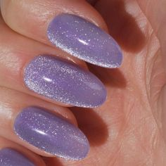 Experience the magic of crushed velvet on your nails! An irresistible gel polish trend that reflects light at every angle to achieve a dreamy effect. #PsychicPlum #ColorIsTheAnswer #OPIVelvetVision #OPIGelColor #OPIGelEffects #ShimmerNails #ShimmerMani #PartyNails #TrendyNails #NailTrends #SparkleNails #FallNails #SparkleMani #GlitterNails #PurpleNails #PurpleMani #GlitterMani #GelMani #FallMani #GelNails #MagneticPolish
