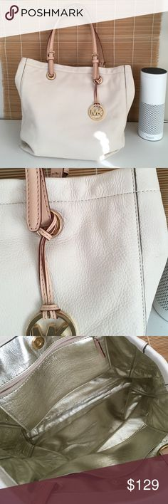 MK cream leather tote Michael Cors cream colored tote with leather strap in excellent condition new without tags it looks like this bag has never been carried. Has gold hardware. SJM0339 Michael Kors Bags Shoulder Bags