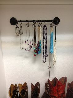 Towel rack with shower curtain hooks hung in my closet for my necklaces!!