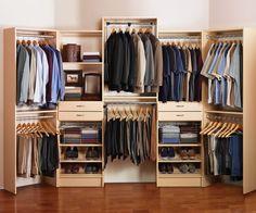 Custom cabinets, shoe racks, drawers, and plenty of rack space help keep this wardrobe organized.
