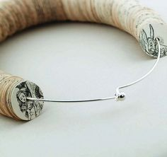 Make jewelry out of old book pages and some wire or other material.