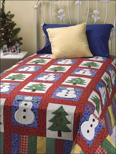 """Appliqued tree and snowman blocks with 3-D accents are sure to be popular with youngsters during the holiday season. This e-pattern was originally published in Quilt a Colorful Christmas. Size: 67 1/2"""" x 90"""". Block Size: 7 1/2"""" x 10"""". Skill Level: Intermediate"""