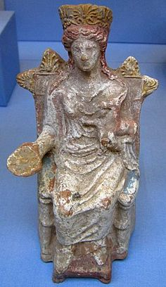 Etruscan goddess painted terracotta. Artemis,sits on he throne with a libation cup in her right hand,holding a fawn with her left arm. c.350 BCE British Museum