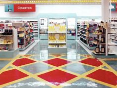 """FW Woolworth (1996). A test at three stores in Wilmington, DE with updated aesthetics and assortments premiered on Friday, August 30, 1996 at locations in downtown Wilmington, Price's Corner Center, and Concord Mall. Awesome use of the iconic red diamond with gold border in the flooring pattern. A nod to their heritage with the storefront letters often gold on a red background and the red diamond with a """"W"""" inside it. Image: website of Joseph Pepe."""