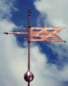 Decorative Banner Weathervane #8 by West Coast Weather Vanes.  This handcrafted decorative banner weathervane was customized by adding some optional ornamental metalwork above and below.