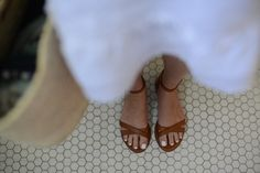 White nail polish and tan leather sandals <3
