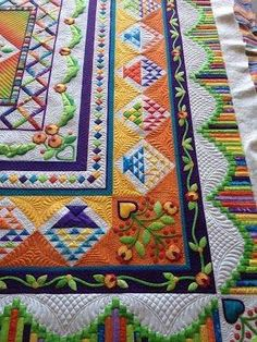 Stunning quilt full of beautiful COLOR! The pattern was last year's BOM for TheQuiltShow, called Ruffled Roses - quilted by Lisa Marie at That Crazy Quilty Girl by wanda