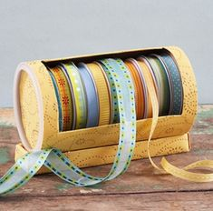 DIY:: Empty oatmeal container= Ribbon storage