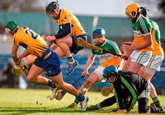 Clare's Colin Ryan jumps clear of the shot on goal by his team mate Aaron Cunningham as goalkeeper James Dempsey, Pat Camon, full back Chris McDonald and Colin Egan defend the Offaly goal Photo: Sportsfile Sports Stars, Goalkeeper, Victorious, Ireland, Athlete, Irish, Coaching, Bunny, Graphics