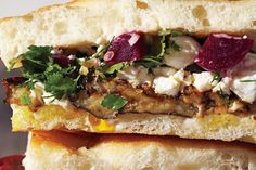 Meatless doesn't mean dainty. When making a veggie-centric sandwich, load up on aggressive flavors and contrasting textures, and be sure to add something substantial to sink your teeth into, like roasted vegetables, sliced hardboiled eggs, or mashed beans. This vegetarian powerhouse from Brooklyn's Saltie balances salty feta and olives with a salad-like mix of fresh herbs. Plenty of pickled, vinegary ingredients (this one uses capers and pickled beets, but any pickled veg would work) keep…