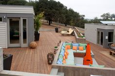 Built in outdoor sectional, natural elements and bright colored accents for @Annie magazine's 2012 Idea Home in Healdsburg, CA.