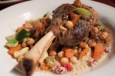 The lamb shank in all its glory - atop flavorful couscous with roasted vegetables