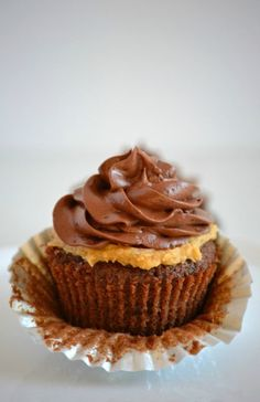 Double Chocolate Peanut Butter Filled Cupcakes - double chocolate cupcakes with a peanut butter cream center topped with chocolate buttercream.: