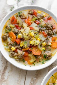 This easy sausage and vegetable soup is total comfort food! The whole family will love this delicious meal. This sausage and vegetable soup recipe is hearty and delicious. Italian sausage, potatoes, and a flavorful broth make a tasty and filling meal. Crockpot Italian Sausage, Italian Sausage Tortellini Soup, Sweet Italian Sausage, Chicken Tortellini, Italian Soup, Chicken Soup, Turkey Soup, Turkey Broth, Vegetable Soup Recipes