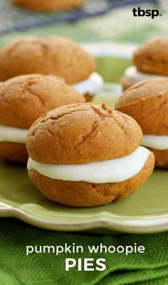 Pumpkin whoopie pies with cream cheese filling inside. These have the perfect amount of spice and are made easy from a cake mix. These pumpkin whoopie pies are moist pillowy cakes packed with spices and filled with cream cheese frosting. Cake Mix Whoopie Pies, Pumpkin Whoopie Pies, Pumpkin Pancakes, Pumpkin Dessert, Baking Recipes, Cookie Recipes, Dessert Recipes, Gf Recipes, Pumpkin Recipes