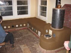 A Rocket Mass Heater is a wood-burning device. Technically neither a woodstove nor a fireplace, the rocket mass heater is related to masonry heaters, rocket stoves, and traditional earthen buildings. In terms of. Small Wood Burning Stove, Wood Burning Heaters, Rocket Stove Design, Home Rocket, Rocket Mass Heater, Rustic Wood Floors, Stove Heater, Rocket Stoves, Natural Building