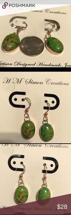 Copper & .825 Sterling Sea Sediment Jasper A-7-042 Beautiful Green 10x14mm Sea Sediment Jasper Cabochons set in copper bezels. The Wires are .925 Sterling Silver with copper accents. These earrings are handmade and one of kind. handmade by HM Simon Jewelry Earrings