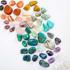 colorful crystals and gemstones organized by color