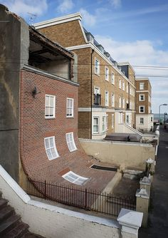 "Alex Chinneck's brilliant and ambitious intervention, in the Cliftonville district of Margate, which saw the artist ""peel off"" the front of a disused house to reveal the decay inside."