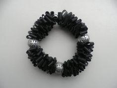 Zwart rubber armband met zilver opengewerkte ronde door assieshop