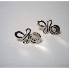 Swirls Sterling Silver Earstuds. Not in the mood for something that dangles.  Check out these swirls of gleaming silver wire stud earrings