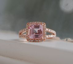 2.8ct Cushion raspberry peach champagne sapphire by EidelPrecious.  Or something a little more platinumy and diamondy.  Love how delicate and the double band.  I asked my wedding ring and it told me it's happy to move over to my other ring finger...