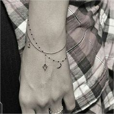 Love these dangling bracelets. 30 Tiny And Stunning Tattoos For Grown-Ups: